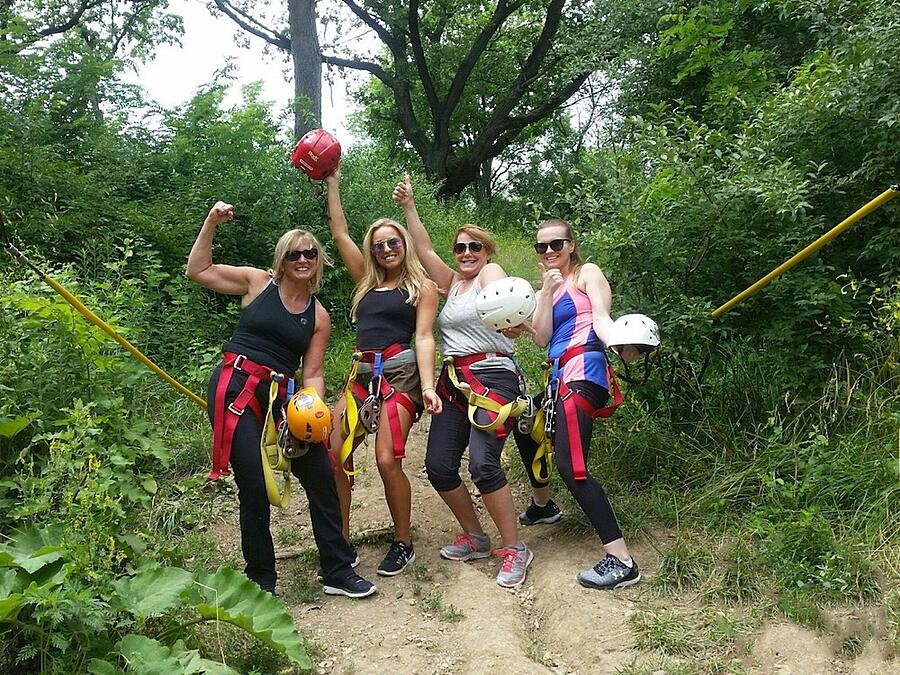 Women celebrating ziplining